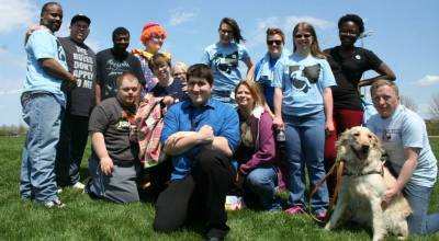 Group of individuals looks at camera smiling.