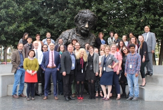 Crowd of people in business dress in front of statue of Albert Einstein in Washington, DC